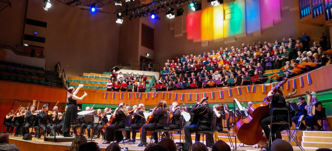 Hundreds of singers and an orchestra performing at the Hand in Hand LGBT+ choral festival in Cardiff's St David's Hall